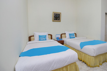 Airy Syariah Mistar Cokrokusumo 29A Banjarbaru - Superior Twin Room with Breakfast Special Promo July 42