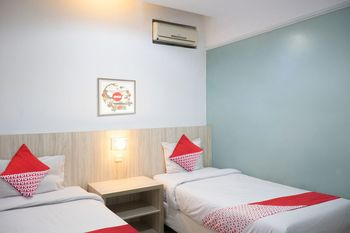OYO 1253 Hotel Wisata Jambi - Deluxe Twin Room Regular Plan