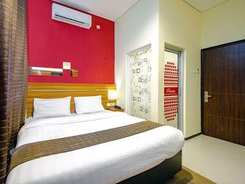 Premier Guest House Jogja Yogyakarta - Deluxe Room Only Regular Plan