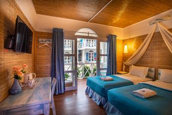 Santorini Beach Resort Lombok - Deluxe Twin Room Pool View Regular Plan