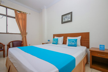 Airy Kota Tinggi Sisingamangaraja 23 Pekanbaru Pekanbaru - Superior Double Room with Breakfast Special Promo Sep 42