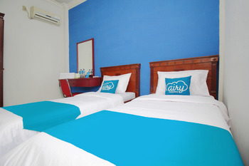 Airy Medan Sunggal Binjai KM 6.7 - Deluxe Twin Room Only Regular Plan