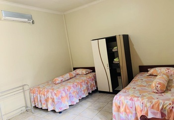 Sola Gracia Guest House Palangka Raya - Deluxe Twin Room Only Regular Plan