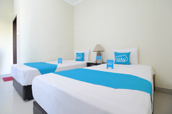 Airy Pantai Kuta Poppies Lane Satu Bali - Superior Twin Room with Breakfast Regular Plan