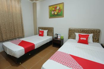 OYO 1864 Tiara Guest House Banjarmasin - Deluxe Twin Room Regular Plan