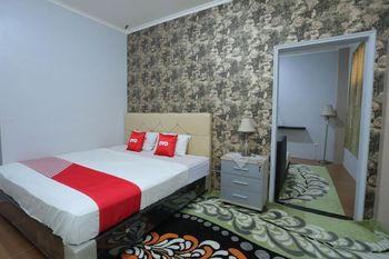 OYO 1864 Tiara Guest House Banjarmasin - Suite Double Regular Plan