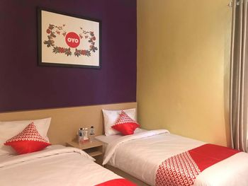OYO 1095 RAP Hotel Danau Toba - Suite Twin Regular Plan