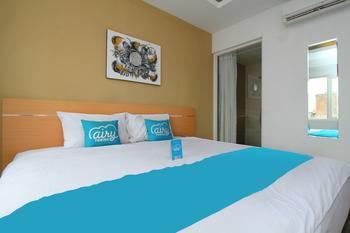 Airy Semarang Barat Amarta Raya - Deluxe Double Room Only Regular Plan