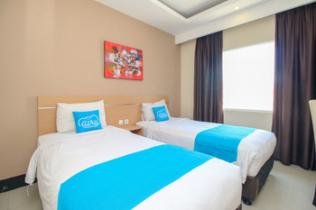 Airy Semarang Barat Amarta Raya - Deluxe Twin Room Only Regular Plan