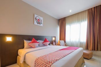 Capital O 1279 Hotel Grand Celino Makassar Makassar - Suite Double Regular Plan