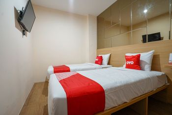 OYO 1574 U_xpress Hotel Palembang - Standard Twin Room Regular Plan