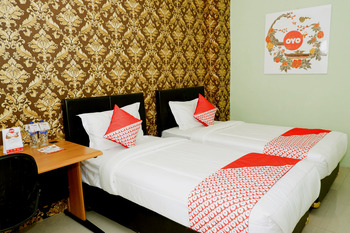 OYO 338 Guest House Omah Manahan Syariah Solo - Standard Twin  Room Regular Plan