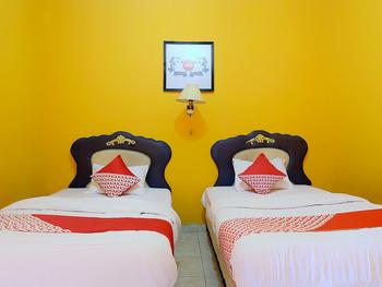 OYO 731 Hotel Matahari 1 Jambi - Deluxe Twin Room Regular Plan