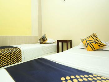 OYO 2879 Pondok Bunda Banjarmasin - Deluxe Twin Room Regular Plan