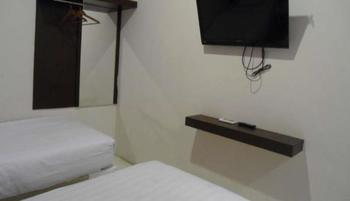 Vindhika Pangayoman Makassar - Deluxe Room Kurma Deal