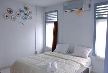 Delima Guest House Tanjung Karang - Deluxe extra Room Regular Plan