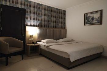 OYO 1282 Feodora Airport Hotel Palembang - Deluxe Double Room Regular Plan