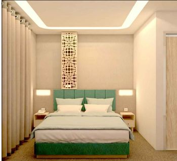 Front One Hotel Gresik Gresik - Deluxe Double Room Best Deal