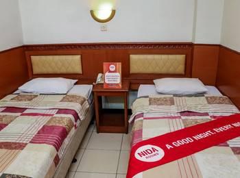 NIDA Rooms Rumah Cibaduyut Building Cihampelas - Double Room Double Occupancy Special Promo