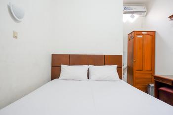 Puspa Indah Guesthouse Semarang - Family Room KETUPAT