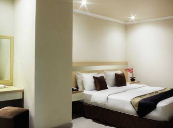 Amos Cozy Hotel Melawai - Deluxe Room With Breakfast Last Minutes deal