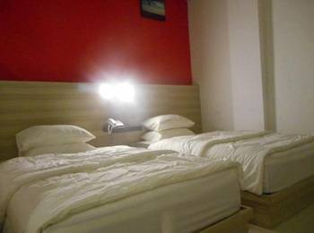Total X Inn Palu - Twin Bed Regular Plan
