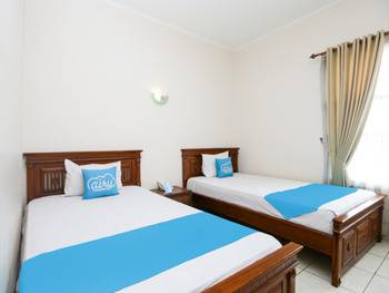 Airy Syariah Bandara Juanda Sidoarjo - Standard Twin Room with Breakfast Special Promo Oct 42