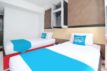 Airy Sario Pierre Tendean Boulevard Manado - Deluxe Twin Room Only Special Promo Mar 5
