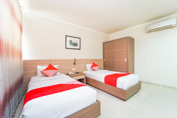 OYO 235 Maumu Hotel & Lounge Surabaya - Deluxe Twin Room Regular Plan