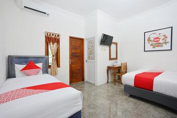 OYO 634 Elga Sastro Inn Syariah Yogyakarta - Suite Triple Regular Plan