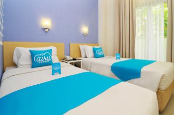 Airy Wenang Sutomo 4 Manado - Superior Twin Room Only Regular Plan