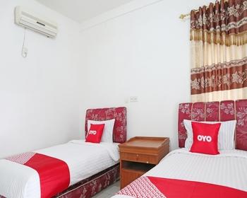 OYO 1538 Pesona Beach Travelodge Padang - Deluxe Twin Room Regular Plan