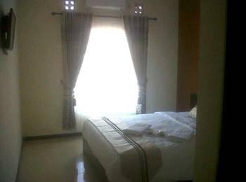 Tya Guest House Malang - Kamar Anggrek Regular Plan