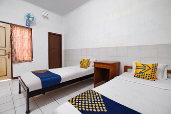SPOT ON 2865 Sartika Inn Pati Pati - SPOT ON Twin Regular Plan