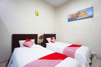 OYO 1236 Elite Residence Manado - Standard Twin Room Regular Plan