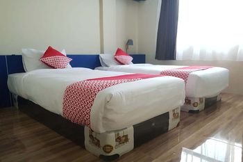 OYO 727 Merlion Hotel Medan - Standard Twin Room Regular Plan