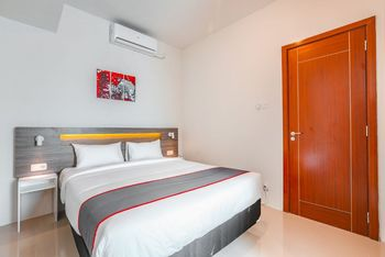Collection O 16 Vittoria Residence Jakarta - Deluxe Double Room Regular Plan