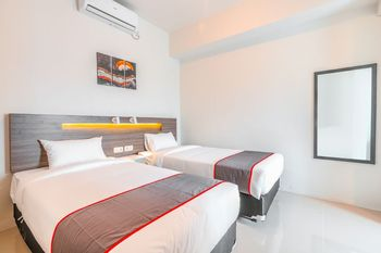 Collection O 16 Vittoria Residence Jakarta - Deluxe Twin Room Regular Plan