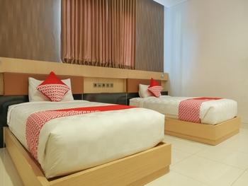 OYO 825 Grand Omah Sastro Yogyakarta - Deluxe Twin Room Regular Plan