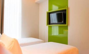 MaxOneHotels at Pemuda Jakarta - Happiness Twin Room Only Regular Plan