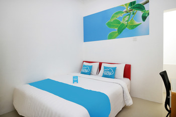 Airy Eco Syariah Padang Andalas Komplek Polamas A88 - Deluxe Double Room with Breakfast Special Promo 11