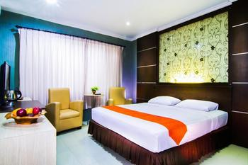 Hotel Griya Dharma Kusuma Bojonegoro - Deluxe Room PegipegiYuk Promo