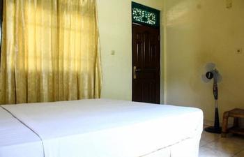 Lolo House Bali - Kamar Standard Single dengan kipas angin Regular Plan