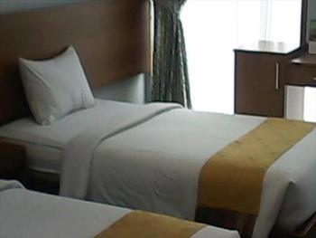 Hotel Surya Palace Syariah Padang - Deluxe Room Breakfast NR Stay More, Pay Less