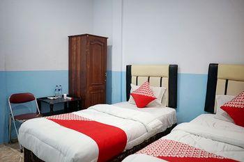 OYO 1531 Hotel Aini Jambi - Standard Twin Room Regular Plan