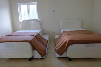 Shakila Guest House Malang - Family Kamar Mandi luar Regular Plan