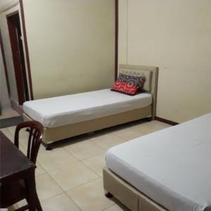 Hotel Prima Padang Padang - Deluxe Twin Regular Plan