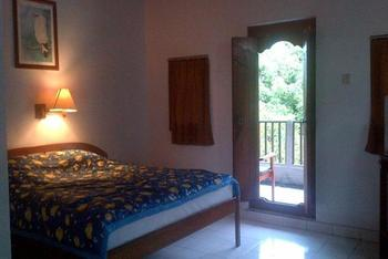 Suji Bungalow Bali - Deluxe Room with AC Regular Plan