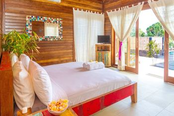 The Palms Ceningan Hotel Bali - Deluxe Bungalow, Partial Ocean View Regular Plan