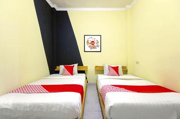 OYO 1058 Paramon Mancasan Yogyakarta -  Deluxe Twin Room Regular Plan